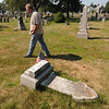 JIm Vaiknoras/Gloucester Daily Times. Ron Ross walks by the grave of Sherburne Morey a Civil War veteran who fought at the Battle of Antietam. The grave at the Oak Grove Cemetary in Gloucester was damaged by vandals.