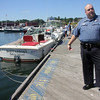 ALLEGRA BOVERMAN/Gloucester Daily Times Manchester Parking Enforcement and Auxiliary Police Officer Tim Migneault talks about how he rescued an elderly man from this dock in Manchester last week.