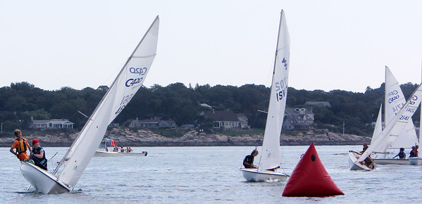 ALLEGRA BOVERMAN/Gloucester Daily Times Participants in the 420 Champions race  prpare to round a float along their race route off Wingaersheek Beach on Monday. The Annisquam Yacht Club is hosting the three-day-long Junior Olympic Sailing Festival.