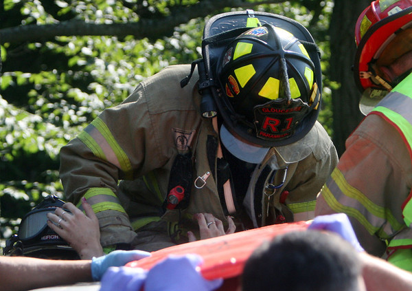 ALLEGRA BOVERMAN/Gloucester Daily Times Gloucester firefighters work to extricate a woman trapped in her car on Thursday afternoon following a crash along Route 128 North near Exit 14. She was taken to Tufts Medical Center by helicopter for treatment.