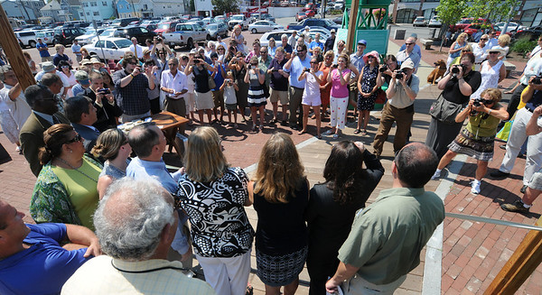 JIm Vaiknoras/Gloucester Daily Times. People crowd St Peter's Square for the ribbon cutting for the Harbor Walk in Gloucester Thursday.