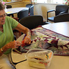 MARIA UMINSKI/Gloucester Daily Times. Natalie Balzarini puts the finishing touches on her quilt she is working on at the Rockport Senior Center.