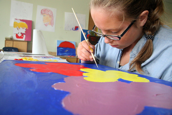 "ALLEGRA BOVERMAN/Gloucester Daily Times Members of the Art Club at Pathways for Children. Working on her canvas that will be auctioned at the upcoming ""A Place at the Table"" Gala in November is Alexis Thompson, 12."