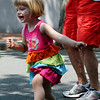 ALLEGRA BOVERMAN/Staff photo. Gloucester Daily Times. Gloucester: Evie Loring, who turned three on Thursday, dances in the street to Beatles songs with her grandmother, Ellie Loring, both of Gloucester, during the  first day of Sidewalk Days downtown.