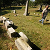 JIm Vaiknoras/Gloucester Daily Times. Ron Ross looks over damage done  by vandals to graves at the Oak Grove Cemetary in Gloucester.