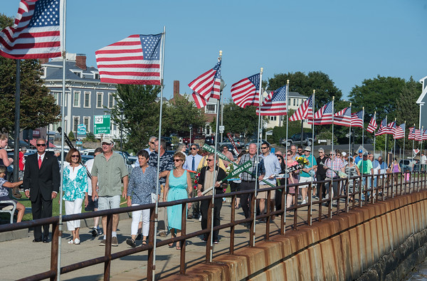 Desi Smith Photo.   The procession makes it's way down Stacey Boulevard in the Annual Gloucester Fishermen's Memorial Service held Saturday afternoon at the Fishermens Monument.     August 27,2016.