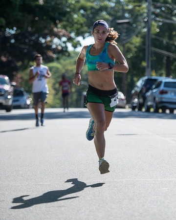 Desi Smith Photo.    Gloucester's Jenn Brooks has a great stride near the half way mark during the Magnolia 5k Road Race held Saturday morning in Magnolia. Brooks placed second with a time of 19:38 for the women. August 27,2016