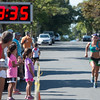 Desi Smith Photo.    Gloucester's Jenn Brooks is cheered on as she crosses the finish, placing second at 19:38 for the women, in the Magnolia 5k Road Race held Saturday morning in Magnolia.  August 27,2016