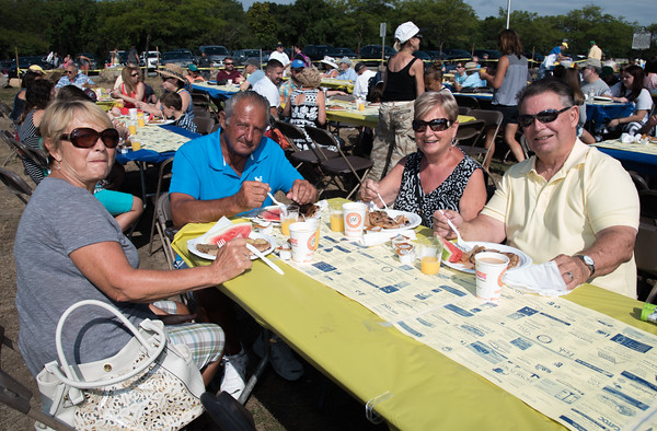Desi Smith Photo.     From left, Madeleine and Louis Ruino and Cecile and Bob Roberde from Griswold,Connecticut, make their annual stop to enjoy the Gloucester Rotary Club's Annual Pancake Breakfast held Saturday morning at Stage Fort Park. This is part of their planned vacation while camping in NH,and have been coming since the start.  August 20,2016