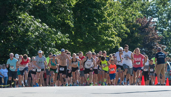 Desi Smith Photo.    Runners take off down Norman Ave in the Magnolia 5k Road Race Saturday morning in Magnolia.  August 27,2016