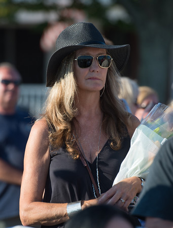 Desi Smith Photo.  Mary Anne Shatford of Gloucester attends the Annual Gloucester Fishermen's Memorial Service held Saturday afternoon on Stacey Boulevard. This year marks the 25th year of the Perfect Storm were she lost her brother Bobby Shatford aboard the Andrea Gail in October 1991.    August 27,2016.