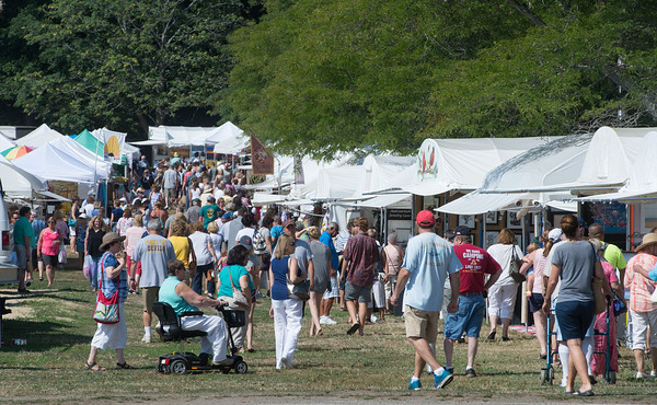 Desi Smith Photo.    Hunderds flock to the Annual Gloucester Waterfront Festival held Saturday at Stage Fort Park.  August 20,2016