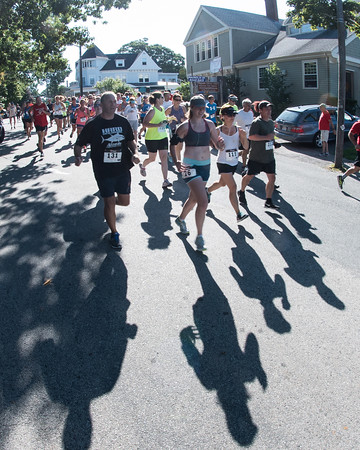 Desi Smith Photo.    Runners follow their shadows as they make their way down Norman Ave in the Magnolia 5k Road Race Saturday morning in Magnolia.  August 27,2016