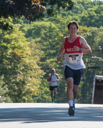 Desi Smith Photo.    Ipswich's Dan O'Flynn keeps his lead over John Ayers of Hamilton during the Magnolia 5k Road Race held Saturday morning in Magnolia. O'Flynn went on to win follwed Ayers for second. August 27,2016
