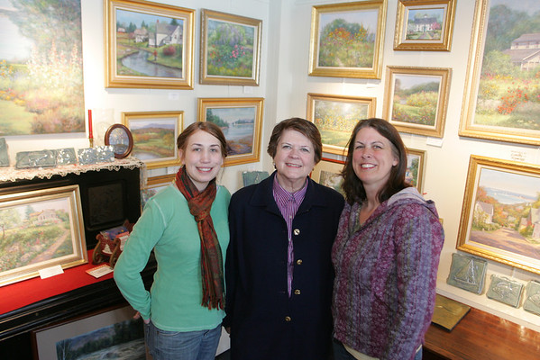 Rockport: Artist Dorothy Ramsey, center, wife to the late Michael Stoffa, and her daughter, artist Mary Douyard, right, run the Michael Stoffa Gallery on Main Street in Rockport.  Doulard's daughter Rachel, left, has  begun showcasing her photography in the gallery as well. Mary Muckenhoupt/Staff Photo
