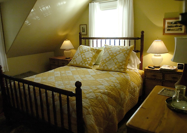 Beverly : A bedroom in the home of Jim Glesener, owner of the Vine and Ivy bed and breakfast in Beverly Farms. <br /> Photo by Linsey Tait/Eagle-Tribune Thursday, January 31, 2008