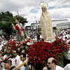 Gloucester: The statues of Our Lady of Fatima and St. Peter stop in front of Our Lady of Good Voyage church on Prospect Street during the Fiesta procession Sunday.  <br /> Photo by Mary Muckenhoupt/Gloucester Daily Times Sunday, July 01, 2007