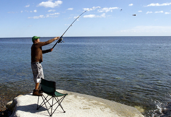 Rockport: Clovis Silva of Medford casts a line off Pebble Beach Wednesday afternoon. Silva says he comes to the area 3-4 times a week to fish. Photo by Katie McMahon/Gloucester Daily Times Wednesday August 20, 2008<br /> Û, Rockport: Clovis Silva of Medford casts a line off Pebble Beach Wednesday afternoon. Silva says he comes to the area 3-4 times a week to fish. Photo by Katie McMahon/Gloucester Daily Times Wednesday August 20, 2008<br /> Û