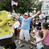 Gloucester:  Jim Sperry cheers wildly for Sponge Bob as he passes by greeting people during the Fishtown Horribles Parade on Stacy Boulevard in celebration of the 4th of July on Thursday evening.  <br /> Photo by Kristen Olson/Gloucester Daily Times Thursday, July 03, 2008