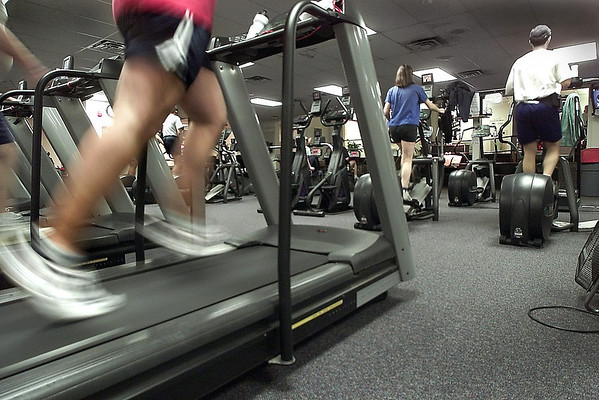 Haverhill: <br />  People working out on various exercise equipment at Cedardale Health and Fitness to go with a story on intense marketing by fitness clubs around the start of the new year,  <br /> Photo by Ken Yuszkus/Eagle-Tribune. Wednesday, December 31, 2003
