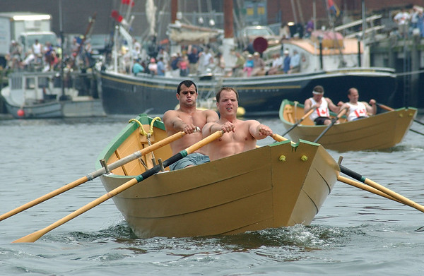 Gloucester: ****for Guide***  International dory races off the Jodrey State Fish Pier, 2002. (Photo by Mike Dean/Gloucester Daily Times). Monday, May 12, 2003 (NOTE: THIS IS A DIGITAL CAMERA IMAGE).<br /> **************************************<br /> Filter: Min (QMPro: Red Radius:0/Blue Radius:3/No Desp.)<br /> USM: Normal (Amt:200/Radius:0.3/Thresh:2)<br /> File Size: 7.46MB<br /> Original file name: DSC_3094.JPG