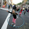 Gloucester: Cara Buchanan, 6, of Gloucester practices her hoola hoop skills during the Block Party on Main Street Saturday evening. Mary Muckenhoupt/Gloucester Daily Times