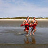 Lifeguards Max Lott, left, and Max Aprans run out of the water at Good Harbor Beach.  Max Lott works at Long Beach and Max Aprans has worked at Gloucester beaches for 7 years. Staff Photo by Mary Muckenhoupt