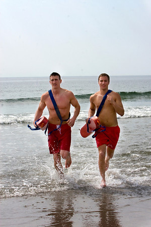 Lifeguards Max Lott and Max Aprans run out of the water at Good Harbor Beach.  Max Lott works at Long Beach and Max Aprans has worked at Gloucester beaches for 7 years. Staff Photo by Mary Muckenhoupt