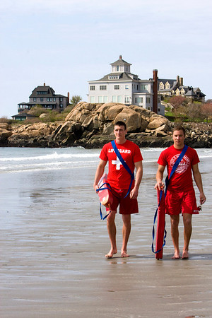 Gloucester lifeguards Max Lott, left, and Max Aprans walk the shoreline of Good Harbor Beach in Gloucester.  Staff Photo by Mary Muckenhoupt
