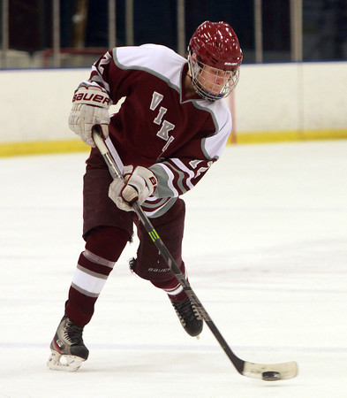 Rockport defenseman Kyle Rollins (12) takes a slap shot from the point against Swampscott on Saturday afternoon. DAVID LE/Staff photo. 12/13/14.