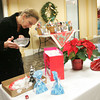 Gloucester: Laura Tarantino puts the finishing touches on the cookies she entered for the Holiday Cookie Contest at Brown's Mall Thursday evening. Good Morning Gloucester held it's first cookie contest with entries judged on taste, texture and overall appearance. Tarantino won the first place prize which was a giant gift basket filled with goodies from local businesses. Mary Muckenhoupt/Gloucester Daily Times