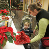 Gloucester: Rachel Refalo drops off her cookie entry with her son Ethan at Brown's Mall for the Holiday Cookie Contest Thursday evening. Good Morning Gloucester held it's first cookie contest with entries judged on taste, texture and overall appearance.  Mary Muckenhoupt/Gloucester Daily Times