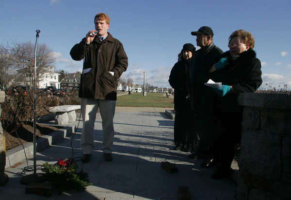 Gloucester: Joseph P. Kennedy III, the grand-nephew of Sen. Ted Kennedy, spoke at a ceremony honoring the late senator for his involvement with the Fisherman's Wives Association at the Fisherman's Wive's statue on Stacy Boulevard Saturday morning. Kennedy is standing over the new inscription honoring Ted Kennedy that is now a permanant part of the stone work around the statue. Mary Muckenhoupt/Gloucester Daily Times.
