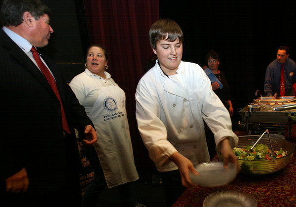 Gloucester: Gloucester High School Principal William Goodwin chats with Linda Geary as Tyler Philbrook sets out more plates during the Rotary luncheon in the high school auditorium. Students in the culinary program helped cook and serve the food. Photo by Kate Glass/Gloucester Daily Times