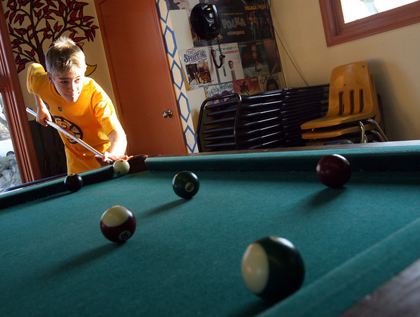 Rockport: Cameron Brousseau shoots pool at the YMCA Ben Beyea Youth and Teen Center yesterday afternoon. The center is open from 12-6 during winter break, but will be closed on New Years Day. Photo by Kate Glass/Gloucester Daily Times