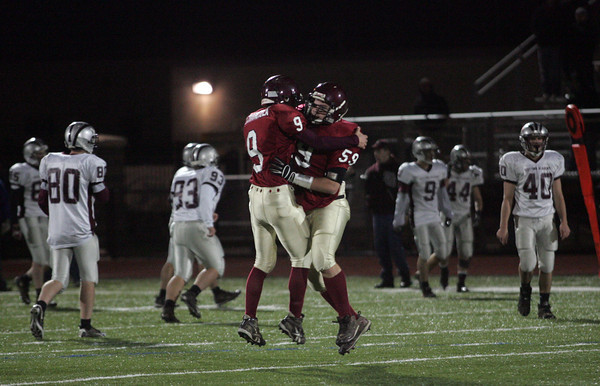 Lynn: Gloucester's Benjamin Chianciola and Max Millefoglie celebrate their 34-28 win over Westford Academy at Manning Field in Lynn last night. Photo by Kate Glass/Gloucester Daily Times