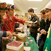 Manchester: Ian Towle, right, patiently waits as Rachel Jones scoops black raspberry ice cream during a fundraiser at the high school yesterday to benefit the Manchester Essex Ski Team, which started its first practice last week. Coach Sam Williamson (next to Jones) says the team expects to have its first practice at Ski Bradford next week. Photo by Kate Glass/Gloucester Daily Times Wednesday, December 9, 2009