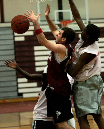 Gloucester: Gloucester's Jim Nicolosi tries to grab the ball while being guarded by Lynn Tech's BJ Batiste and Cameron Womack during a scrimmage last night. Photo by Kate Glass/Gloucester Daily Times Tuesday, December 8, 2009