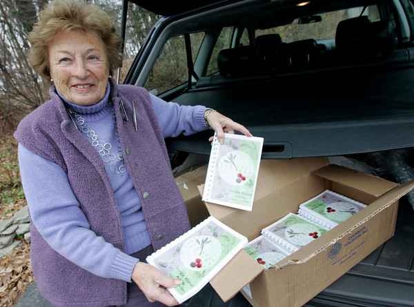 """Gloucester: Erma Cohen has sold over 100 copies of Temple Ahavat Achim's cookbook, """"Our Best Recipes,"""" from the back of her car. Photo by Kate Glass/Gloucester Daily Times Monday, December 7, 2009"""