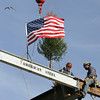 Rockport: A ceremonial tree was placed atop the Shalin Liu Performance Center on Main Street in Rockport Friday mornng.  The small evergreen tree attached to the beam isn't a nod to Christmas.,rather it's a Scandinavian tradition that honors those who worked on the construction and symbolizes the future growth of the building. Mary Muckenhoupt/Gloucester Daily Times