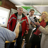 "Essex: Charles Curtis from North Shore 104.9  holds the microphone as School Committee Chair Greg Verga, Heidi Dalin, City Council elect Bob Wynott sing ""White Christmas"" as Sen. Bruce Tarr holds another microphone at the toy drive held at Woodman's in Essex Thursday afternoon. Mary Muckenhoupt/Gloucester Daily Times"
