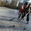 Rockport: Dasa Hase tries to steal the puck from Jon Dailey while skating on a quarry off Pigeon Hill Street Wednesday afternoon. Jon said it was his first time playing hockey, though he'd been on skates before. Photo by Kate Glass/Gloucester Daily Times