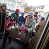 Gloucester: Alexandre Jean and Martha Maggie carry in a box of toys as the Eastern Point Day School brings toys the students donated to the TCB House Friday morning. Every year the Easter Point Day school delivers a tree from the school's lobby and christmas presents from the students to the TCB, Taking Care of Business, House which is a home for families in transistion located just down the street form the Eastern Point Day School. The school also donates two turkey dinners for the families to have on Christmas. Mary Muckenhoupt/Gloucester Daily Times