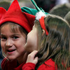 "Gloucester: Beeman Elementary School kindergarteners Rhuana Ramirez, left, and Ellie Sutera, right, giggle while singing ""Jingle Bells"" during the school's holiday concert yesterday afternoon. Photo by Kate Glass/Gloucester Daily Times Wednesday, December 16, 2009"
