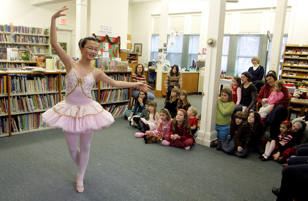 """Essex: Kimberly Dawes perfoms to Tchaikovsky's """"Dance of the Sugar Plum Fairies"""" form the Nutcracker during the Nutcracker celebration at the TOHP Burnham Library Saturday afternoon. The event included holiday stories and yummy cookies and snacks. Mary Muckenhoupt/Gloucester Daily Times"""