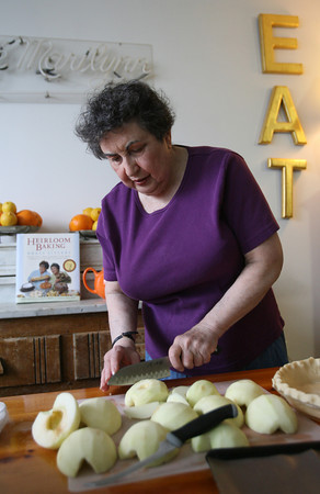Sheila Brass slices apples for the custard apple pie. Photo by Kate Glass/Gloucester Daily Times