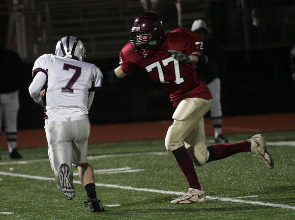 Lynn: Gloucester's Andrew Mizzoni sacks Westford Academy's Patrick Dugan during the Fishermen's 34-28 win at Manning Field in Lynn last night. Photo by Kate Glass/Gloucester Daily Times