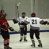 Gloucester: Rockport's Brendan Douglass and Derrek MacDowell celebrate Douglass' goal as Amesbury's Justin Isaac skates past at the Talbot Rink yesterday. Photo by Kate Glass/Gloucester Daily Times