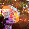 Rockport: Lila Jylkka, 5, stays dry while posing for a picture in front of the Christmas tree in Dock Square after the tree was lit Saturday afternoon. Mary Muckenhoupt/Gloucester Daily Times