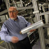 Gloucester: Dick Murphy, Vice Chairman of Gloucester Engineering, displays a type of plastic wrap the WOW winder can produce. Although the company suffered during the recession, it is bouncing back. Photo by Kate Glass/Gloucester Daily Times